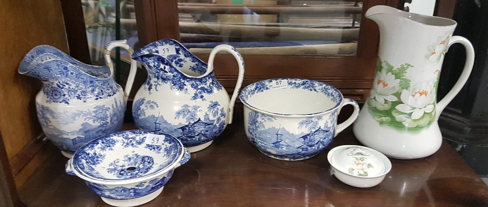 Lot 57 - 3 pottery Ewers (2 blue and white, 1 with repaired handle), 1 blue and white pot, 2 soap dishes (6)