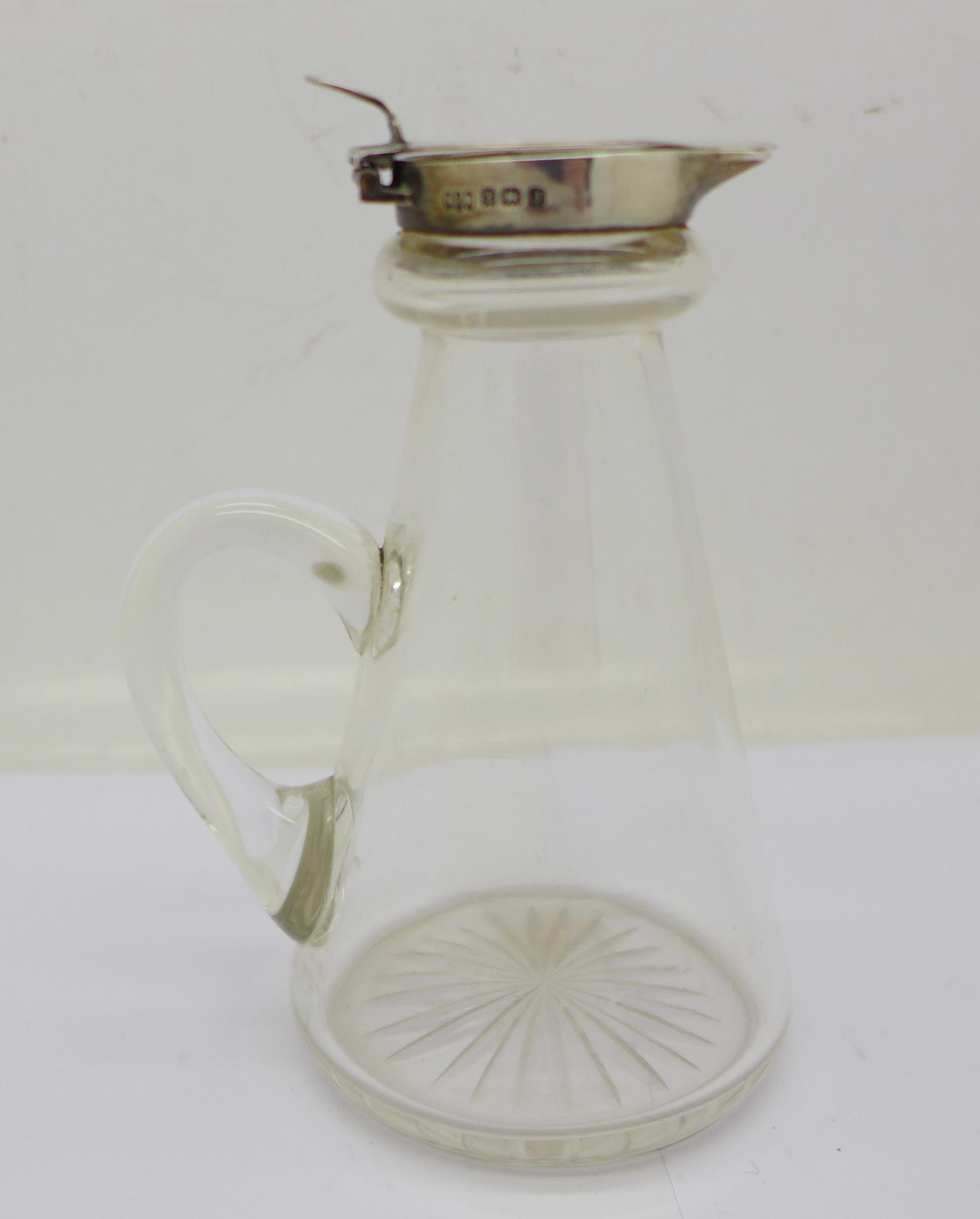 A silver topped glass noggin,