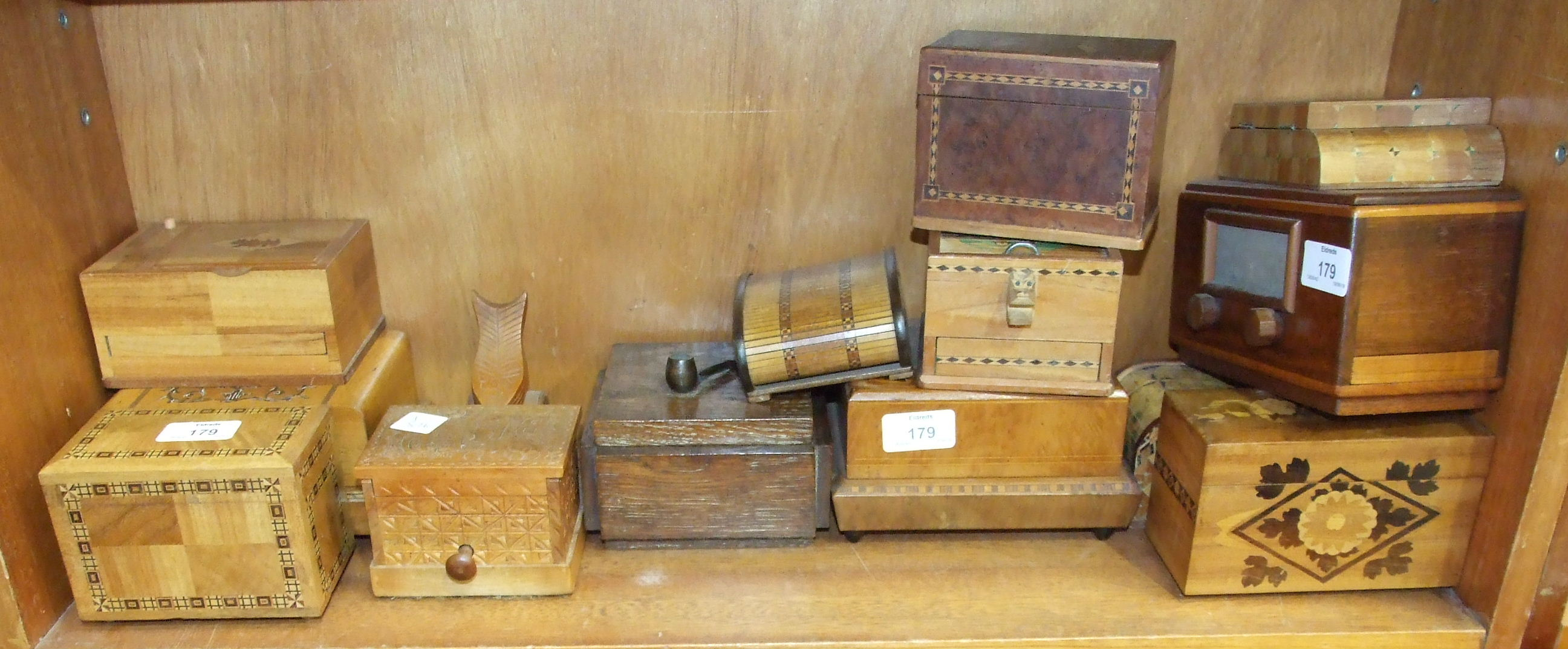 Lot 179 - A collection of wooden novelty cigarette boxes, many with parquetry decoration.