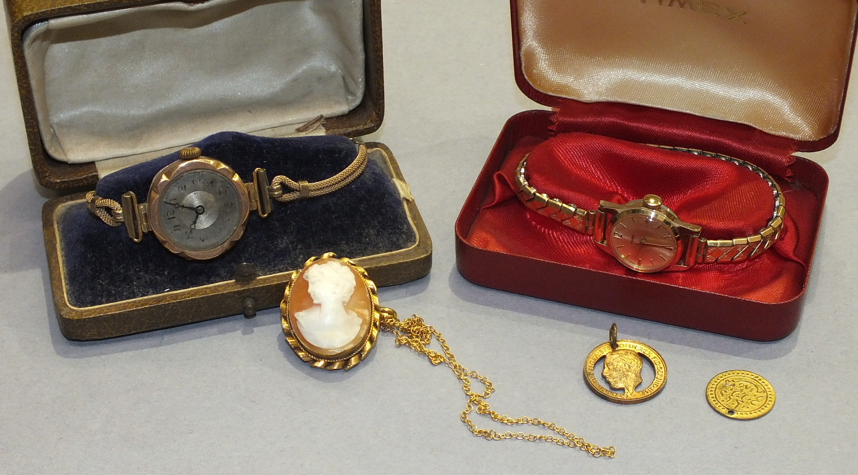 Lot 249 - A shell cameo brooch/pendant on 9ct gold neck chain, a ladies 9ct-gold-cased wrist watch, (a/f),