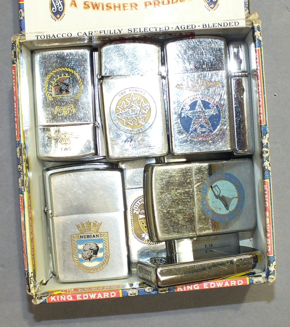 Lot 245 - A collection of thirteen various 'Zippo' lighters.
