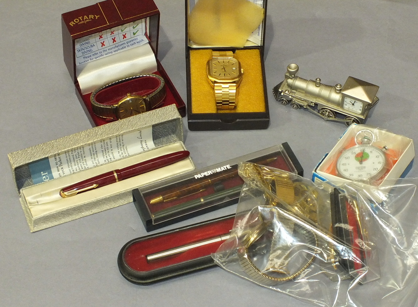 Lot 196 - Two pairs of binoculars, a Rotary quartz yellow metal wrist watch and other items.