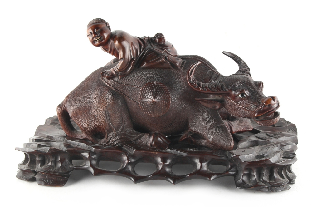Lot 278 - A late 19th / early 20th century Chinese carved hardwood model of a recumbent buffalo, on fitted