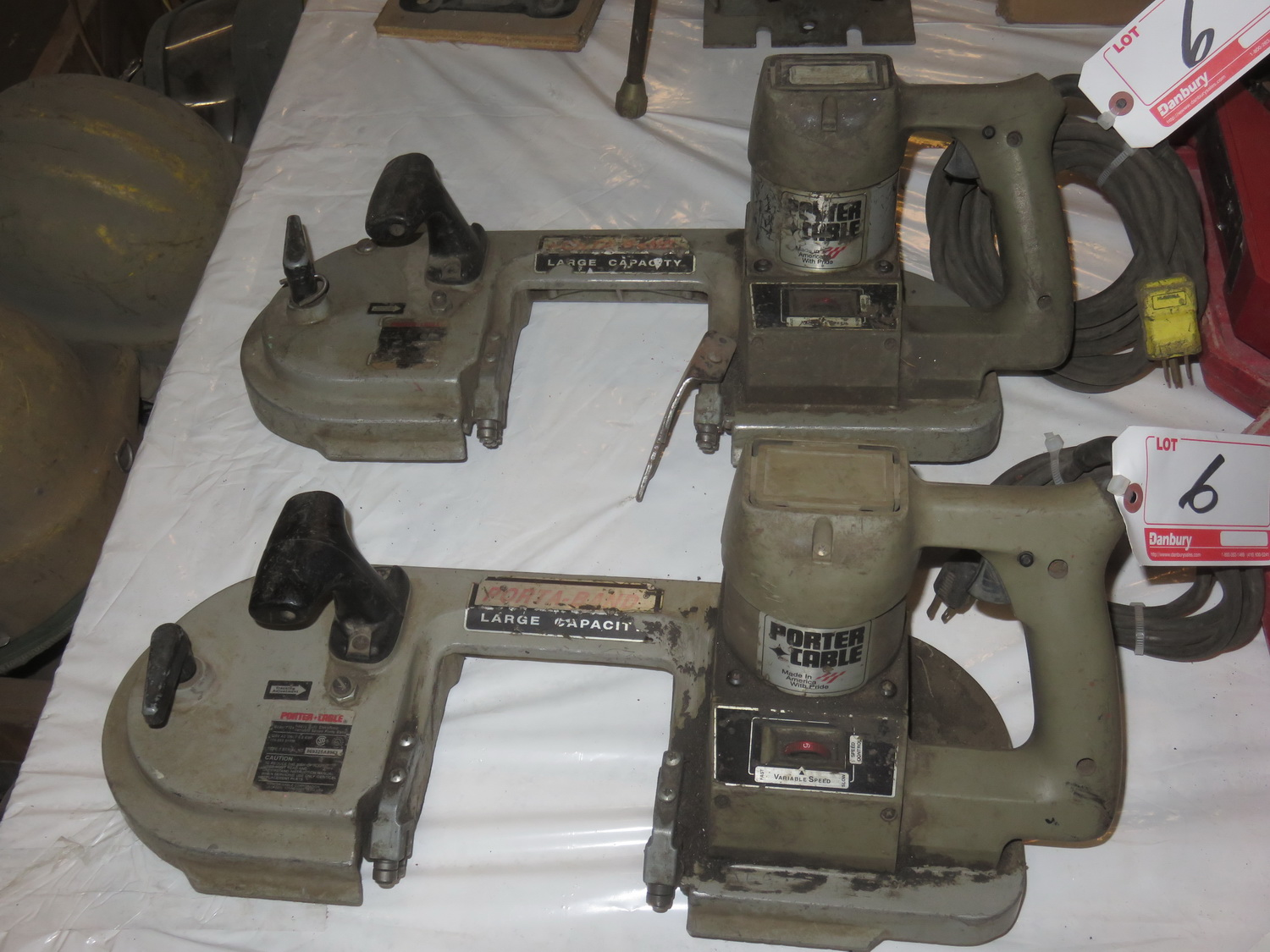 Lot 6 - LOT - PORTER CABLE ELECTRIC HAND BAN SAW CUTTER (NO BLADES)