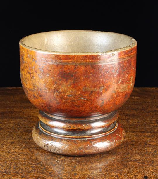 Lot 24 - A Large Antique Turned Treen Mortar/Bowl raised on a moulded foot with turned hollow to the