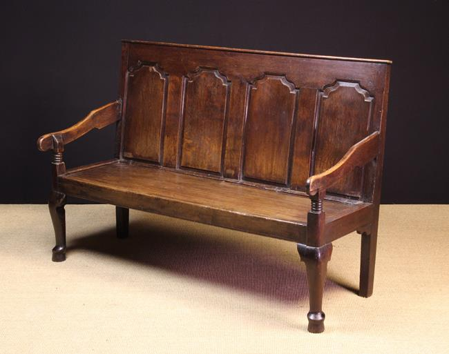 Lot 59 - A 19th Century Joined Oak Settle. The back composed of four ogee topped fielded panels.