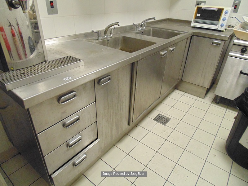 Lot 1228 Moffat Stainless Steel L Shaped Kitchen Workstation Comprising Of Four Drawer Unit Double Bowl Utensil Sink With Door Under Cupboard