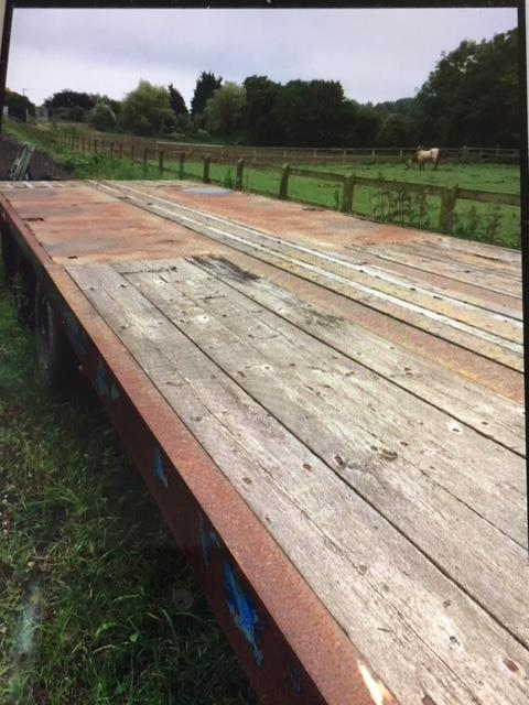 Lot 1 - Step frame trailer 8m flat x 4m step, sound condition, hydraulic and air brakes.