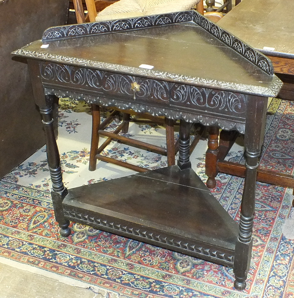 Lot 17 - An oak drop-leaf table, an oak corner table, three rush-seated chairs and one other chair, (6).