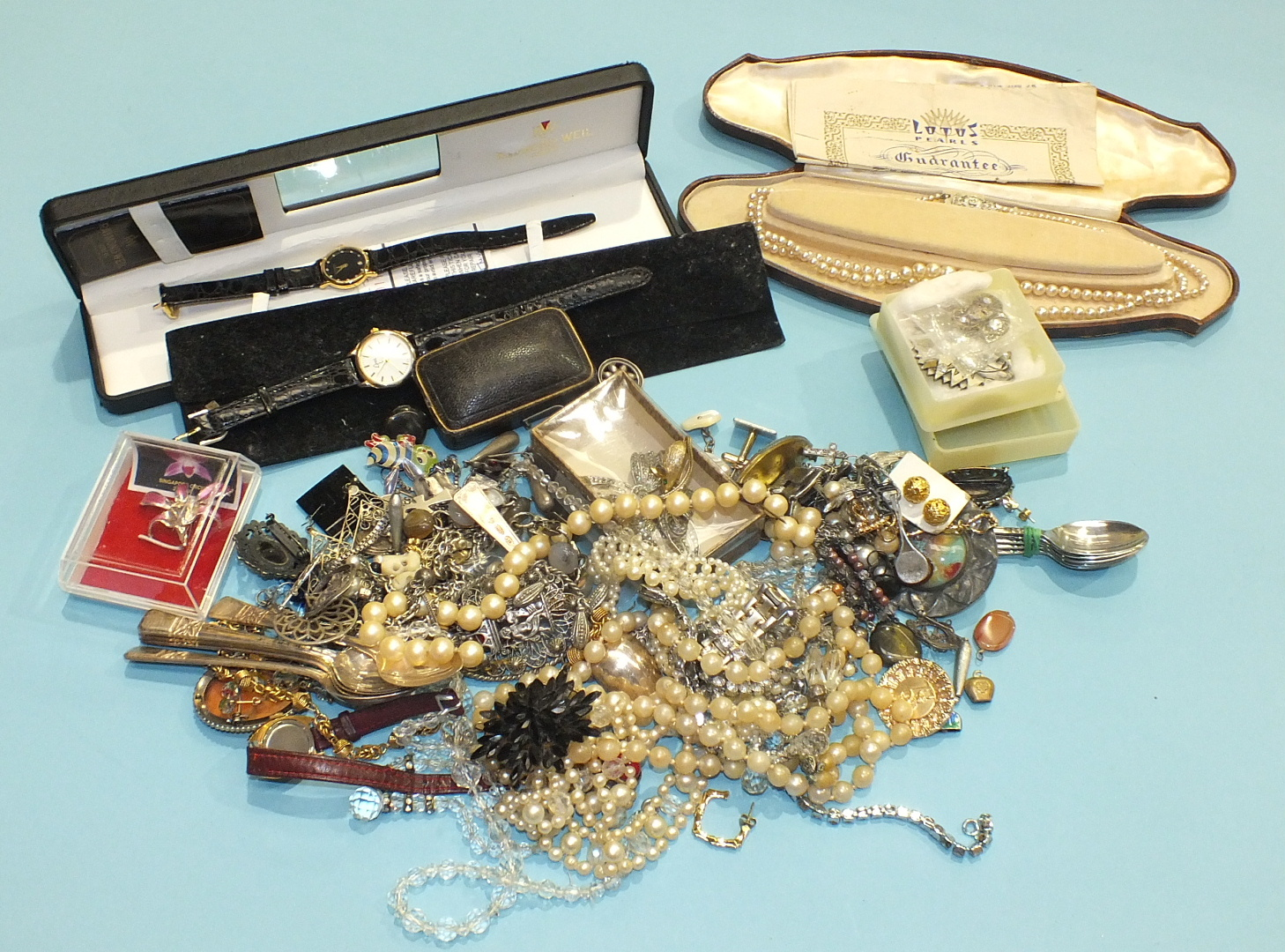 Lot 235 - A quantity of costume jewellery and watches.