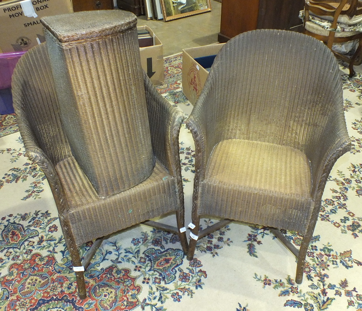 Lot 46 - Two Lloyd Loom bedroom chairs and a matching linen basket, (3).