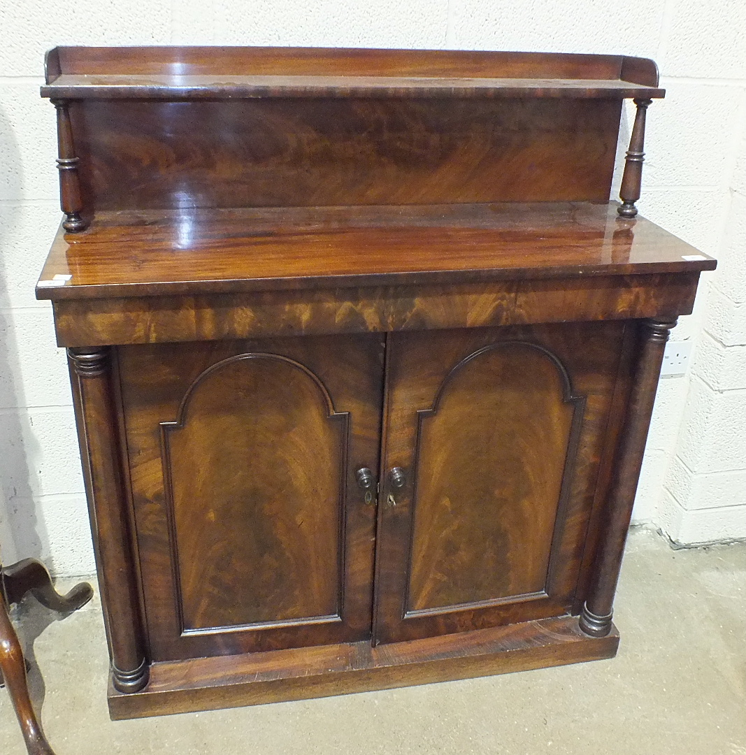 Lot 11 - A Victorian mahogany chiffonier, the low shelved back above a pair of panelled doors flanked by