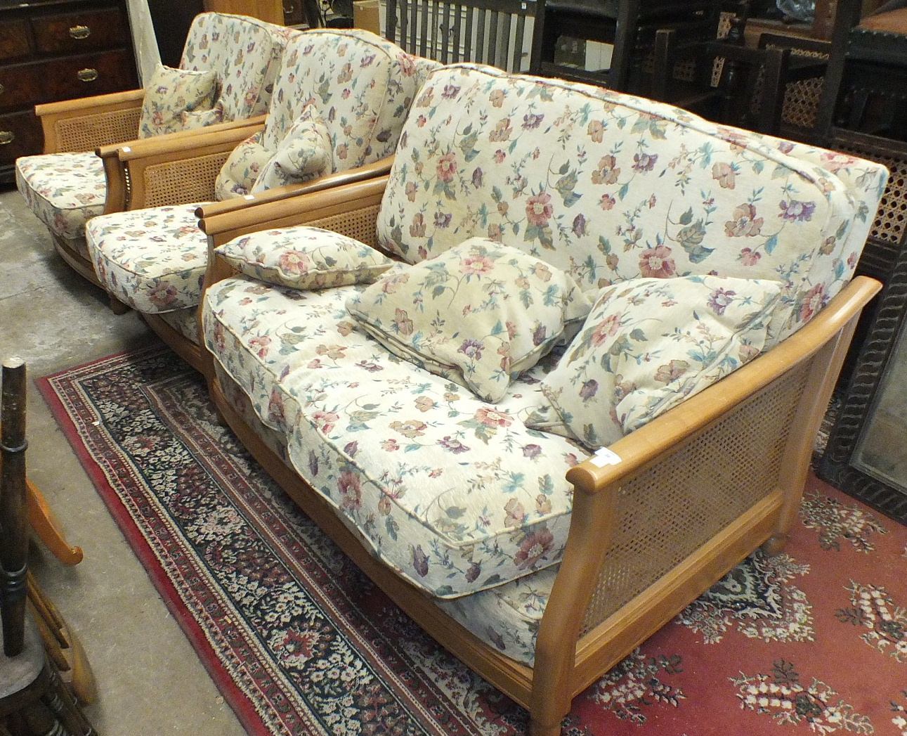 Lot 36 - A modern Ercol Bergère-style light wood two-seater settee with cane sides and loose cushions and two