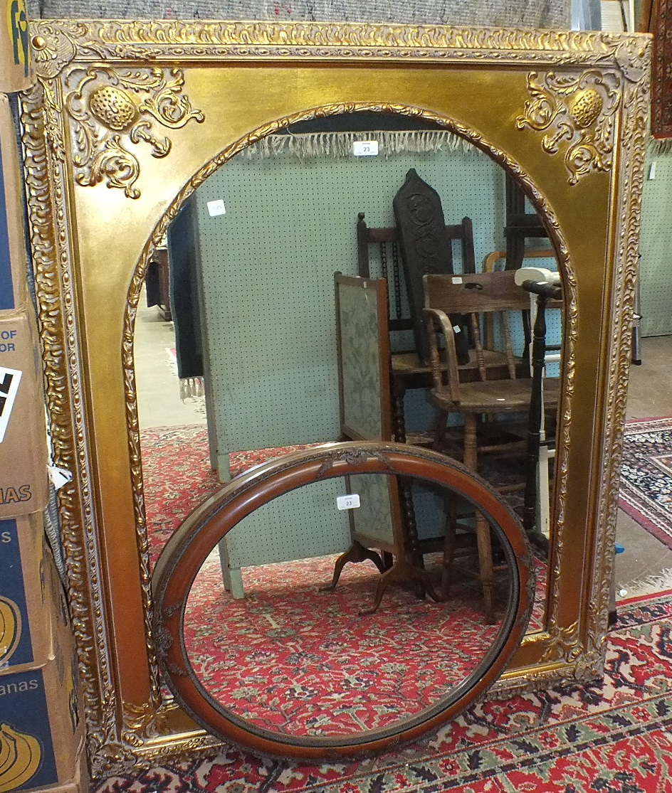 Lot 23 - An arched mirror in gilt frame, 101 x 128cm and an oval mirror, (2).