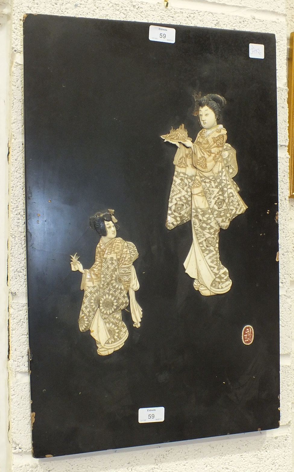 Lot 59 - A late-19th/early-20th century Japanese ivory and lacquered panel depicting two female figures,