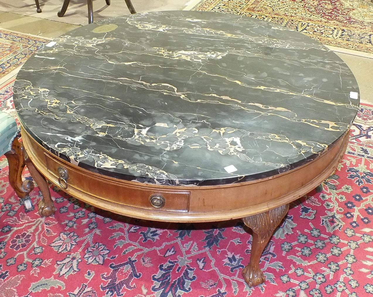 Lot 3 - A modern circular marble-top low coffee table, 106cm diameter.