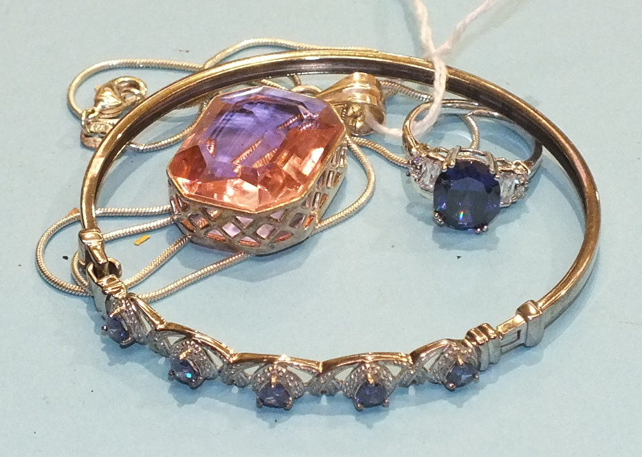 Lot 240 - A synthetic sapphire and cubic zirconia silver-mounted ring, a similarly-set bangle and a silver