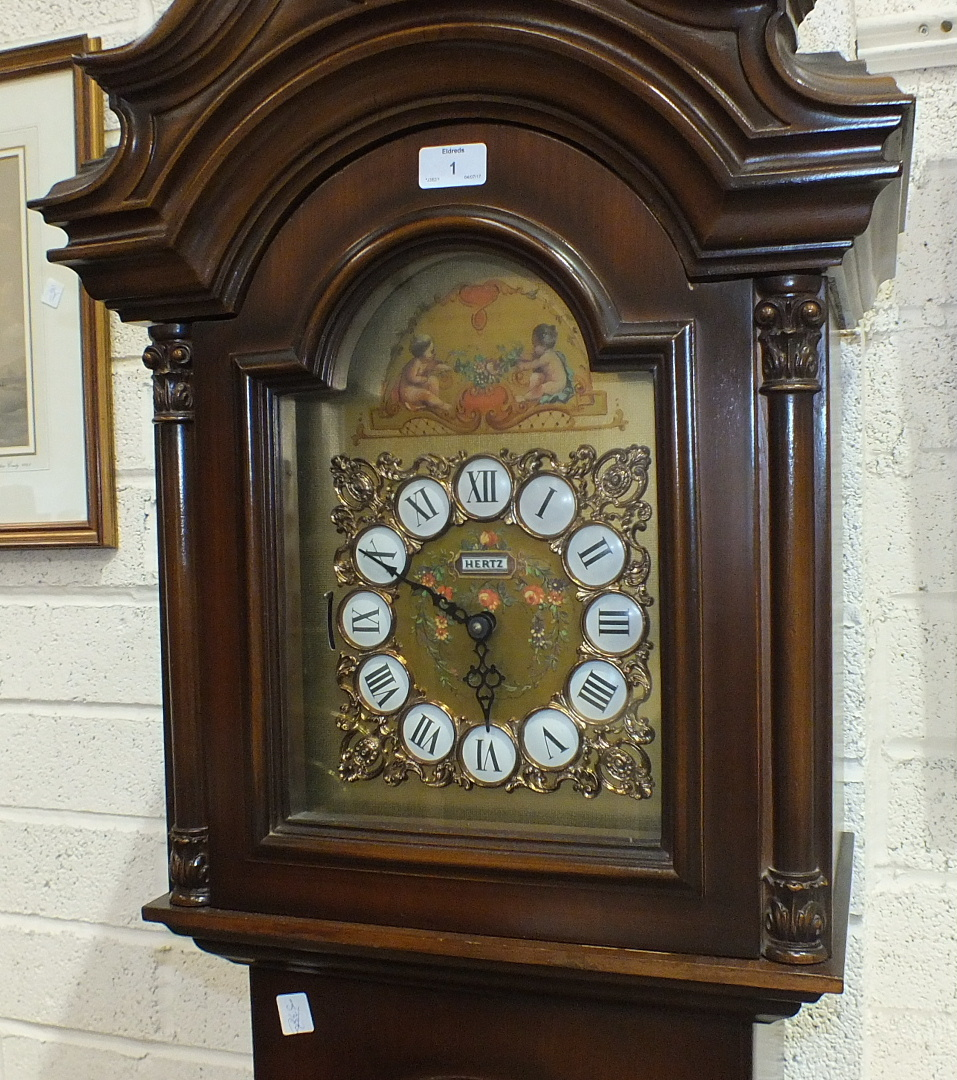 Lot 1 - A 20th century mahogany long case clock, the brass dial inscribed Hertz, the movement striking on