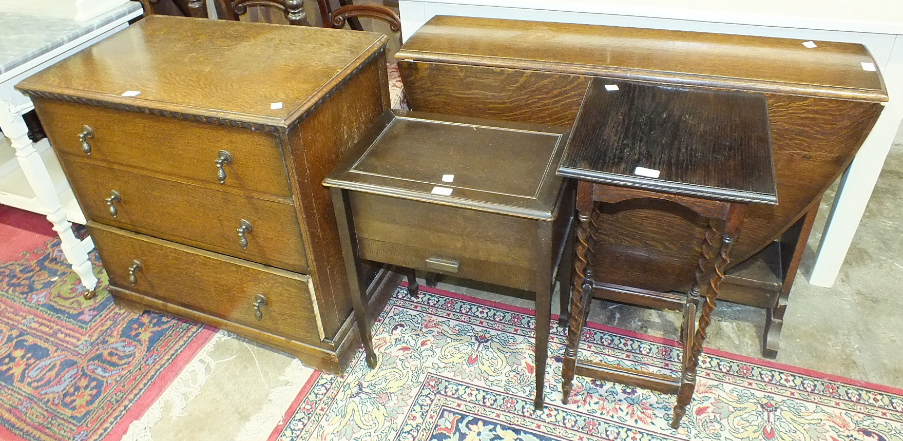 Lot 5 - An oak chest of three drawers, 80cm wide, a drop-leaf table and other items.