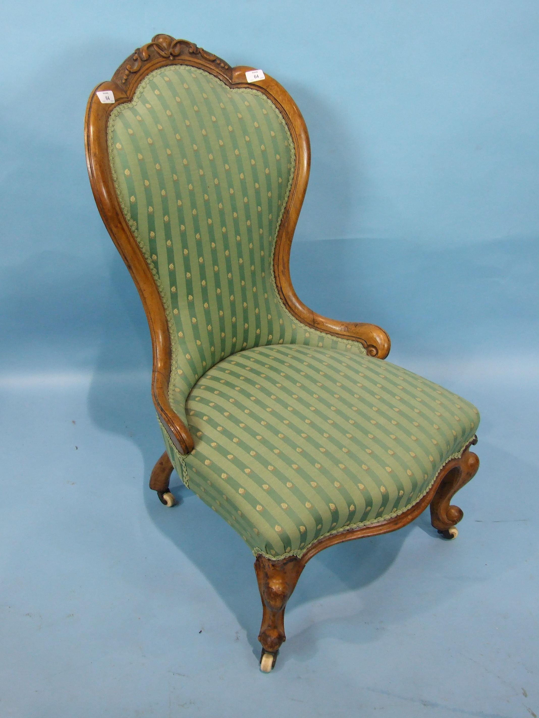 Lot 12 - A Victorian walnut salon chair, the carved shaped back and serpentine upholstered seat on cabriole