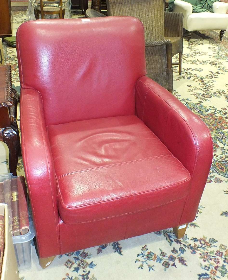 Lot 34 - A modern leather-upholstered armchair with loose cushions, (complies with 1988 Fire Regulation