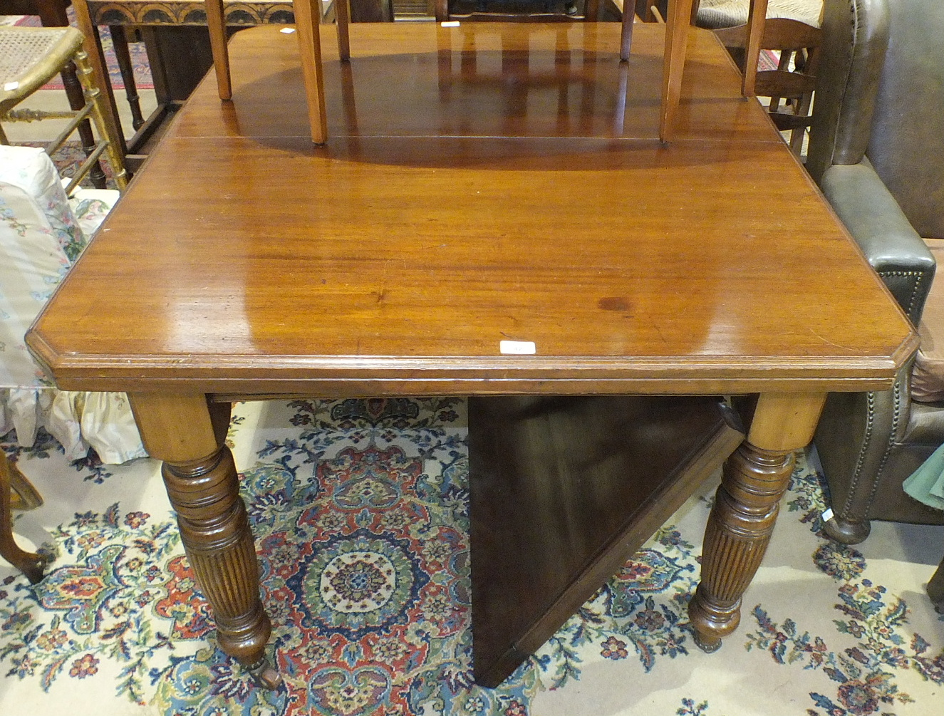 Lot 42 - A Late-Victorian mahogany small extending dining table, 105 x 120cm, with spare leaf.