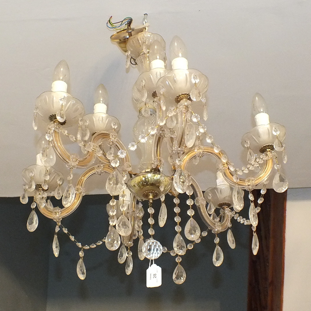 Lot 28 - A modern glass nine-branch chandelier with lustre drops, 61cm high, 61cm diameter.