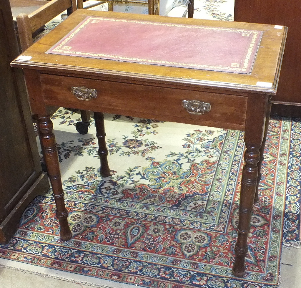Lot 49 - A stained mahogany writing table, the rectangular top with inset above a frieze drawer, on turned