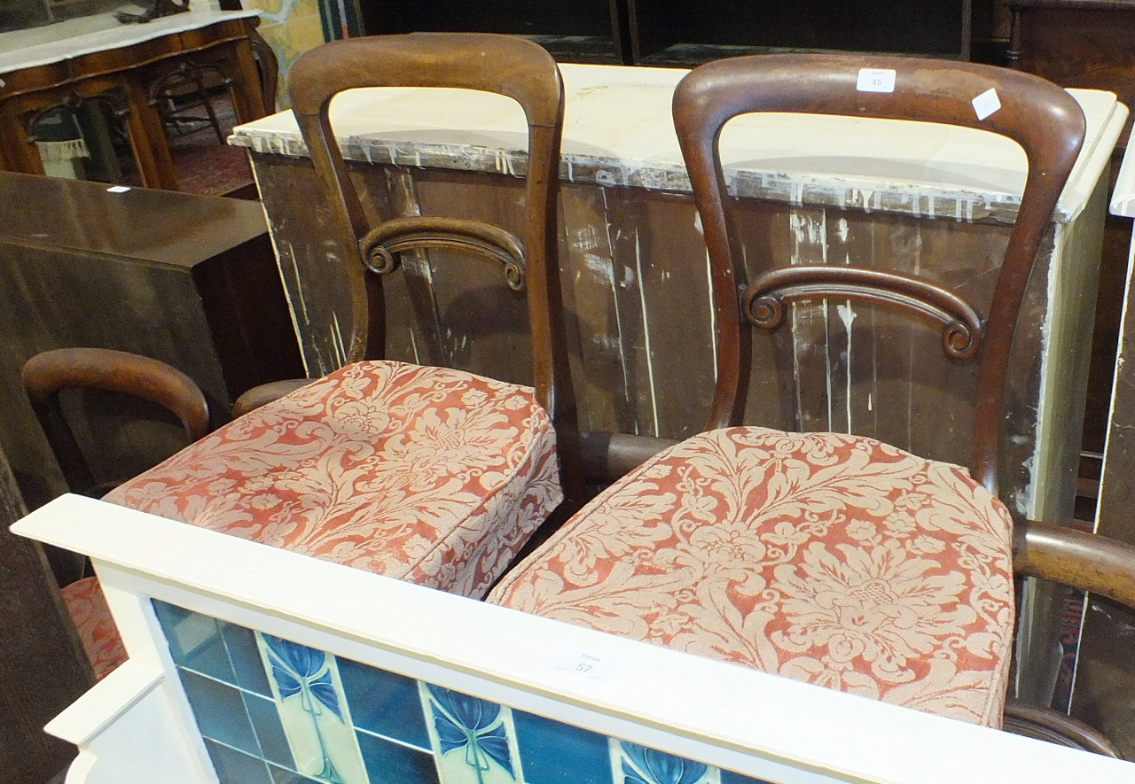 Lot 45 - Nine Victorian mahogany balloon-back dining chairs, each with curved back and carved rail, on