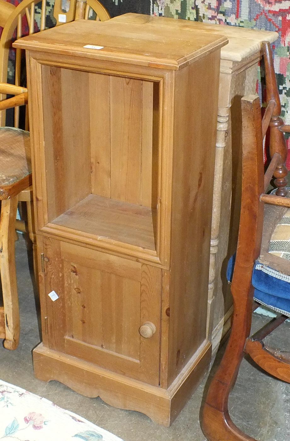 Lot 31 - A stripped pine narrow three-tier bookshelf, 43cm wide, 85.5cm high and a modern pine bedside