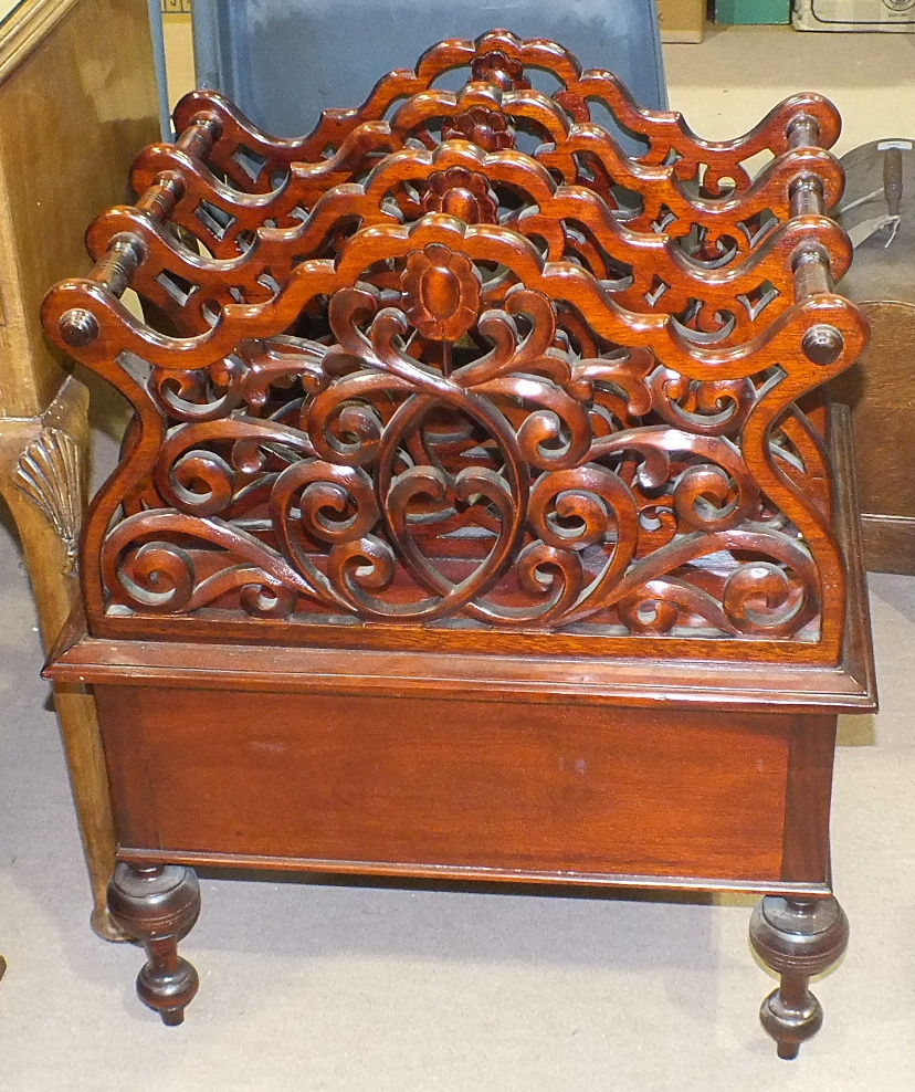 Lot 2 - A modern mahogany finish three-division music Canterbury with fitted drawer, on turned legs, 57cm