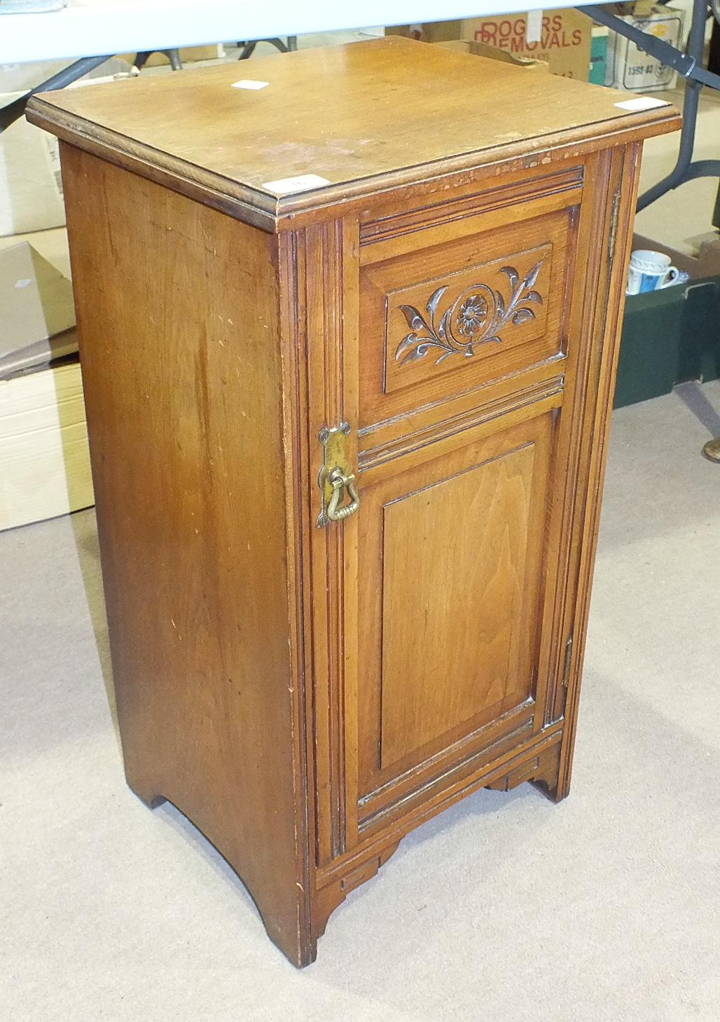 """Lot 16 - An Edwardian walnut pot cupboard with label for """"John Finch & Co, London"""", 38cm wide, 71cm high."""