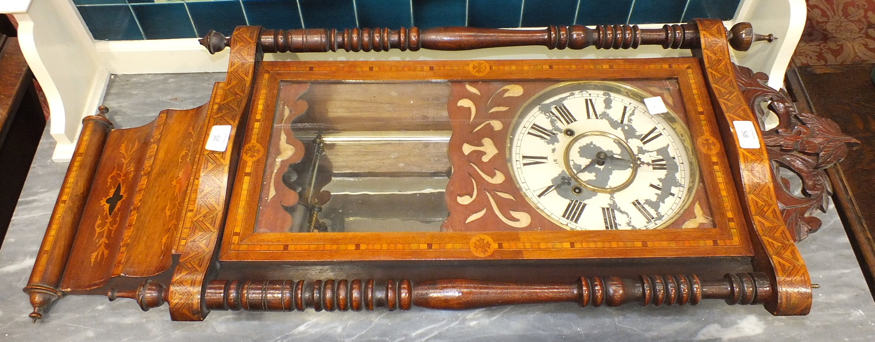 Lot 58 - An inlaid stained wood case striking wall clock, (a/f, paint flaking from dial), 94cm high.
