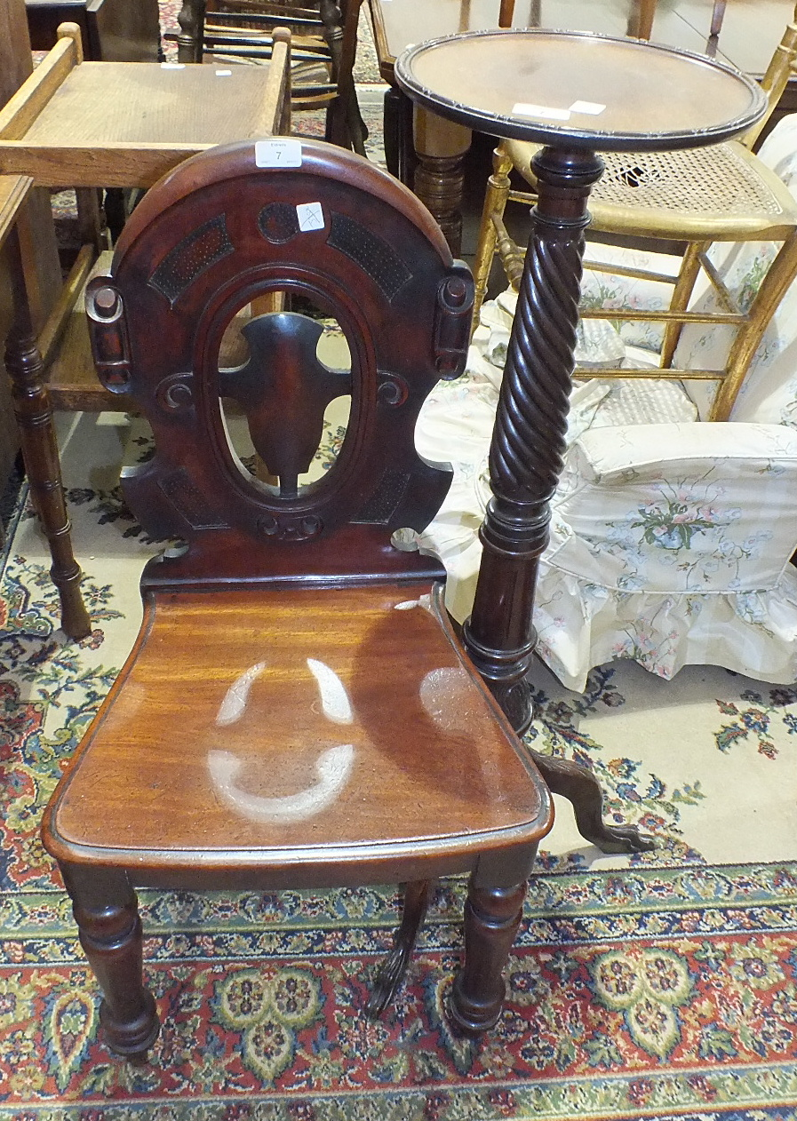 Lot 7 - A mahogany carved torchère stand and a Victorian mahogany hall chair, (2).