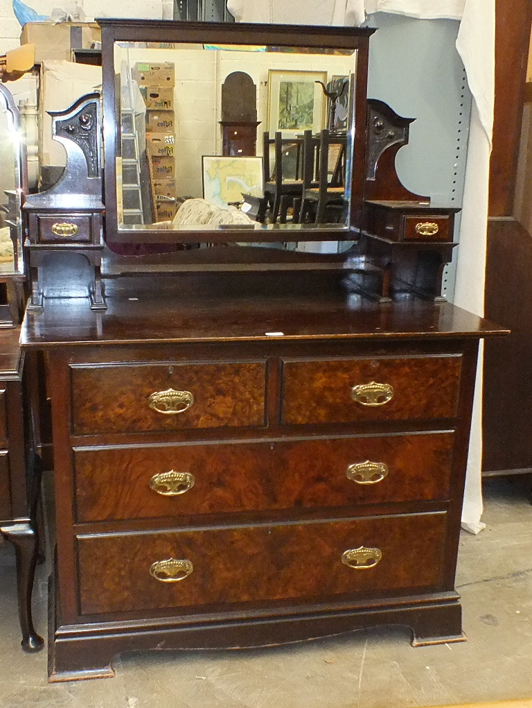 Lot 10 - A walnut dressing chest with Art-Nouveau-style brass handles, 108cm wide, also a walnut dressing