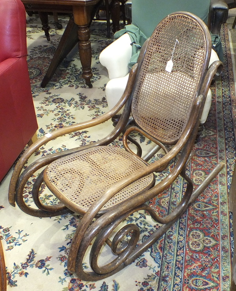 Lot 35 - A bentwood caned-back-and-seat rocking chair.