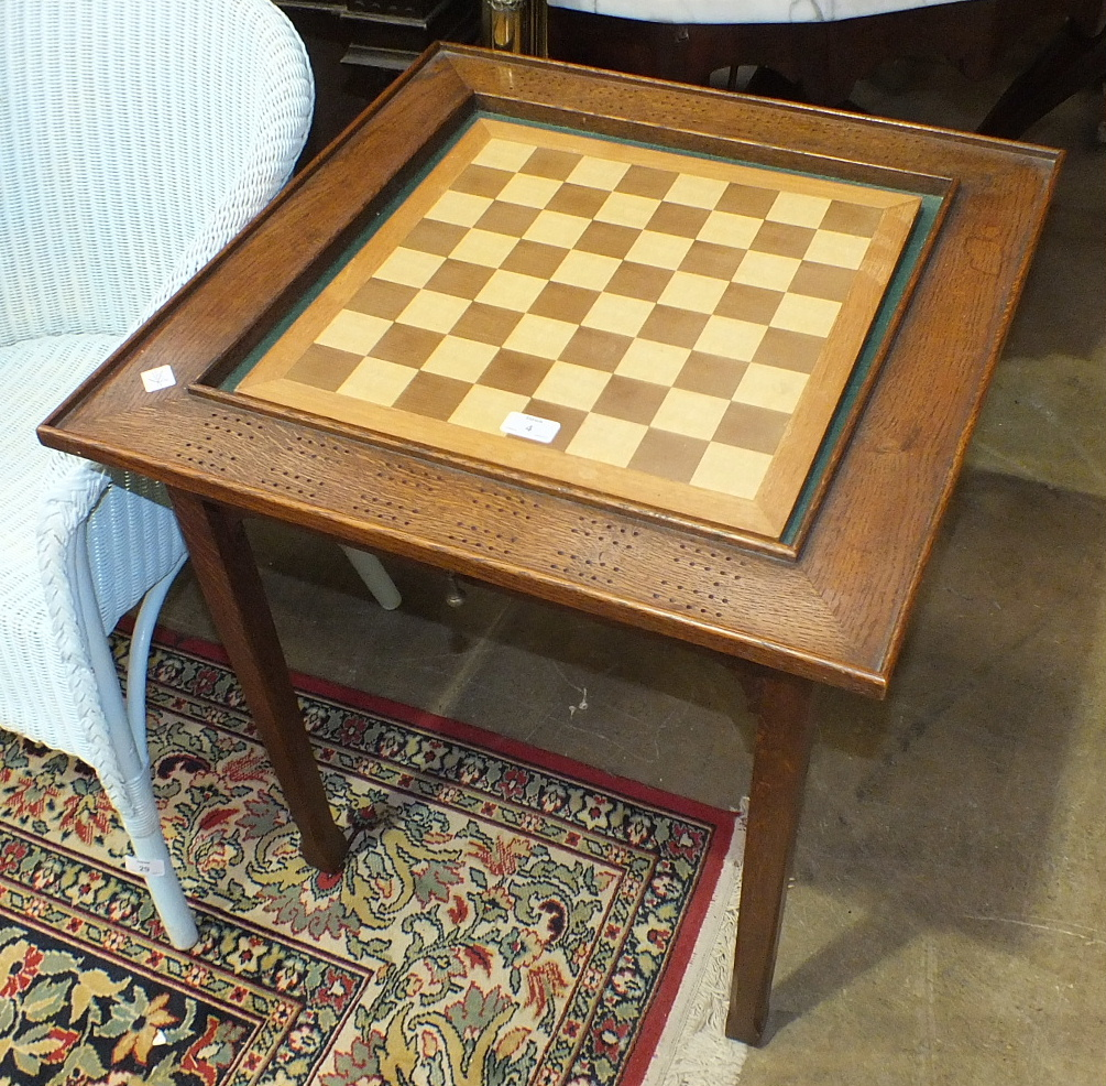 Lot 4 - An oak Euchre or Cribbage table with central baize and pierced border score boards, 60cm, a