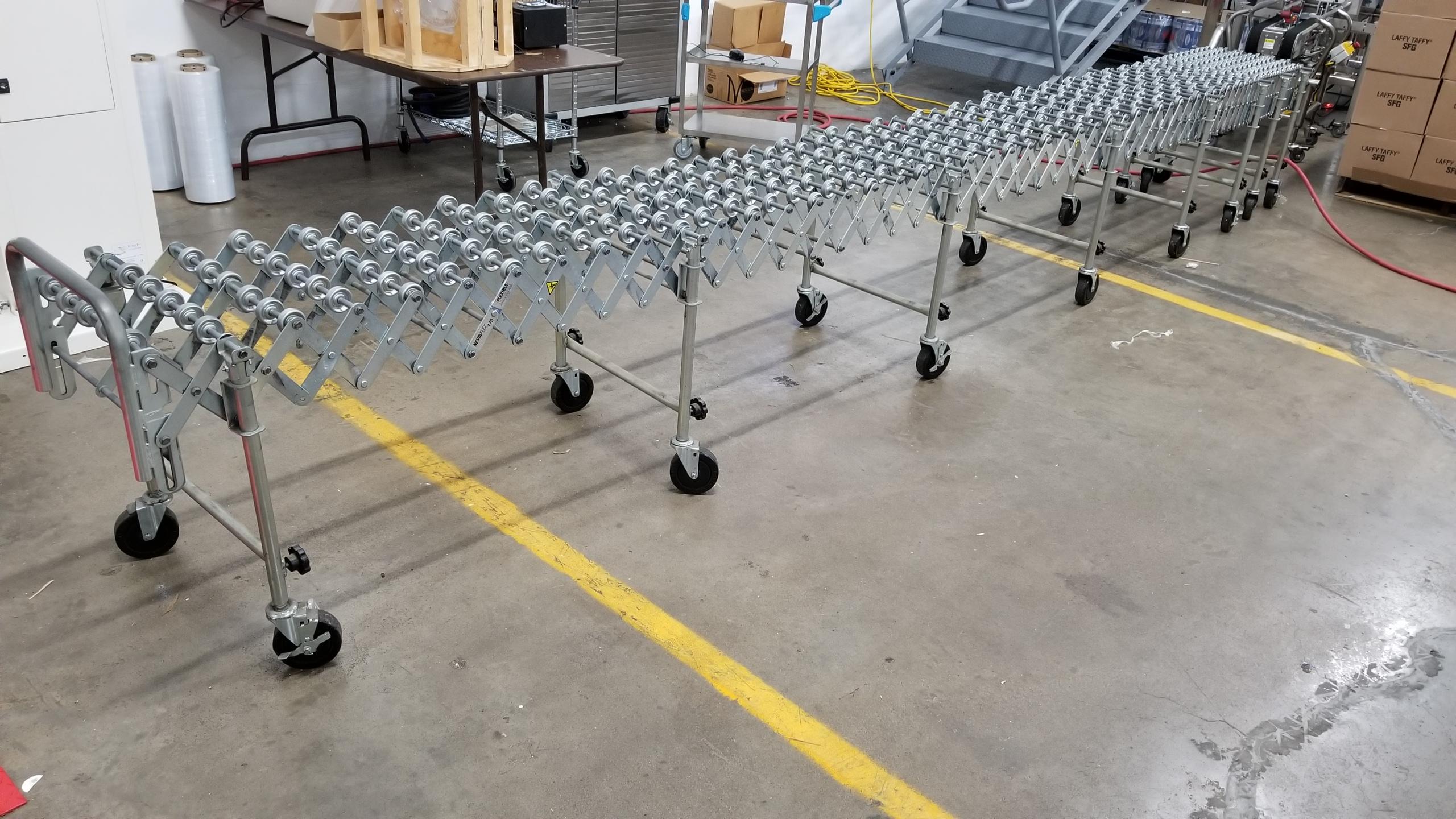 "Lot 51 - Nestaflex 175 approximately 18"" wide x 21-ft long Skate Conveyor"