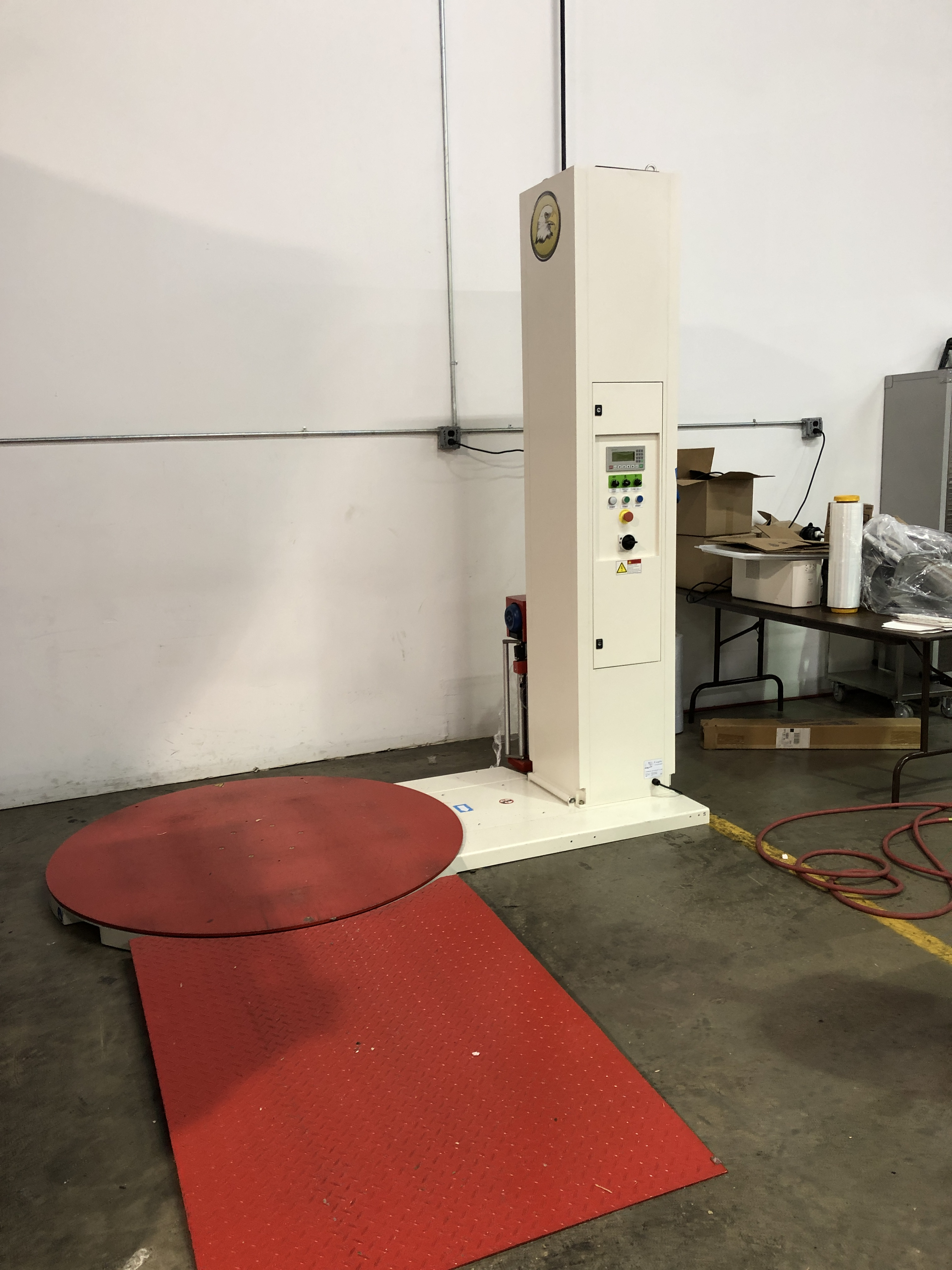 """Lot 52 - Eagle 2000B Semi-Automatic Pallet Stretch Wrapper. 59"""" diameter turntable with ramp. Max product"""