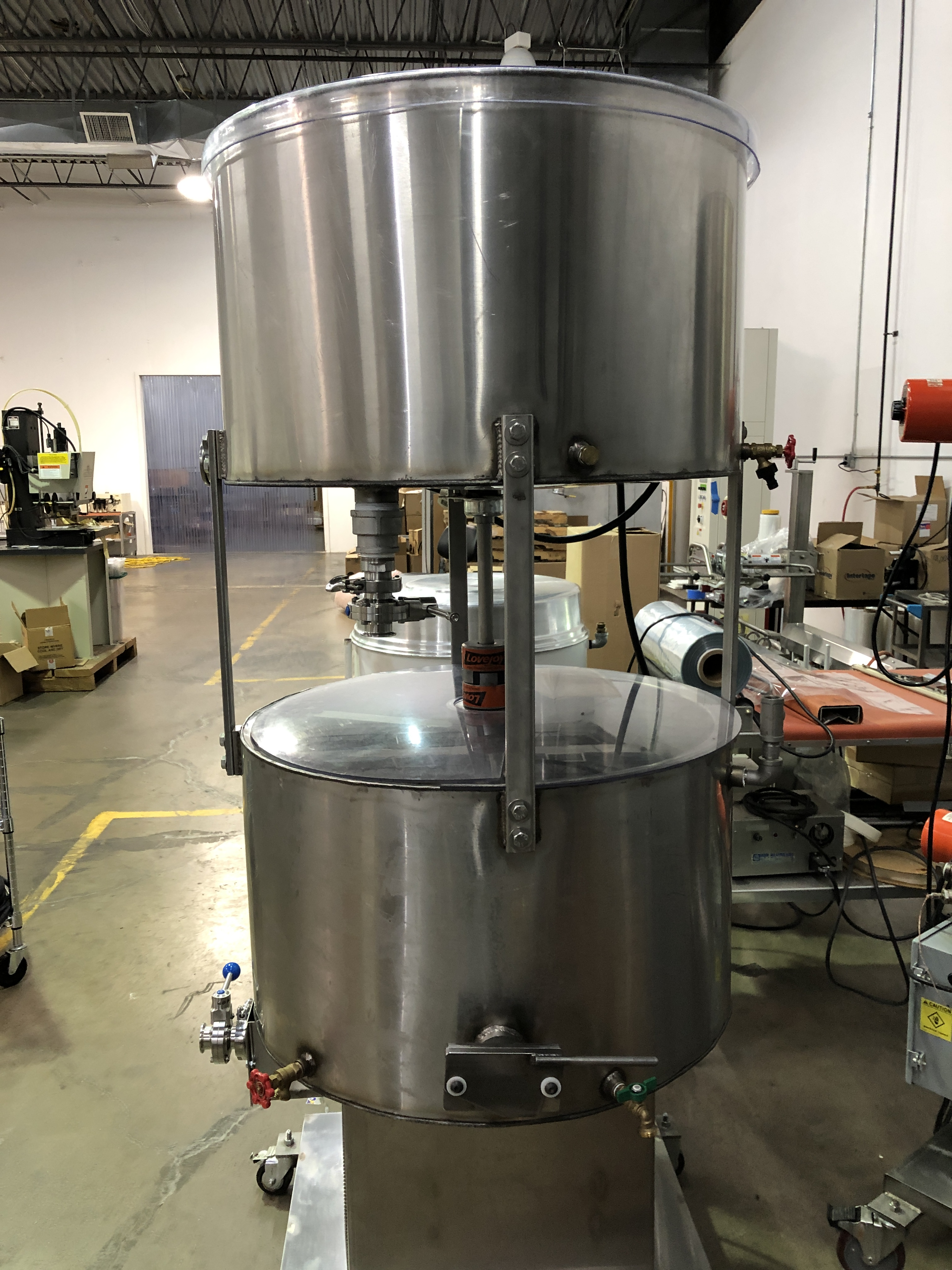 """Lot 1 - Chocolate Concepts 450/450 lb Stainless Steel Stack Chocolate Melter. Each tank 30"""" diameter x 16"""""""