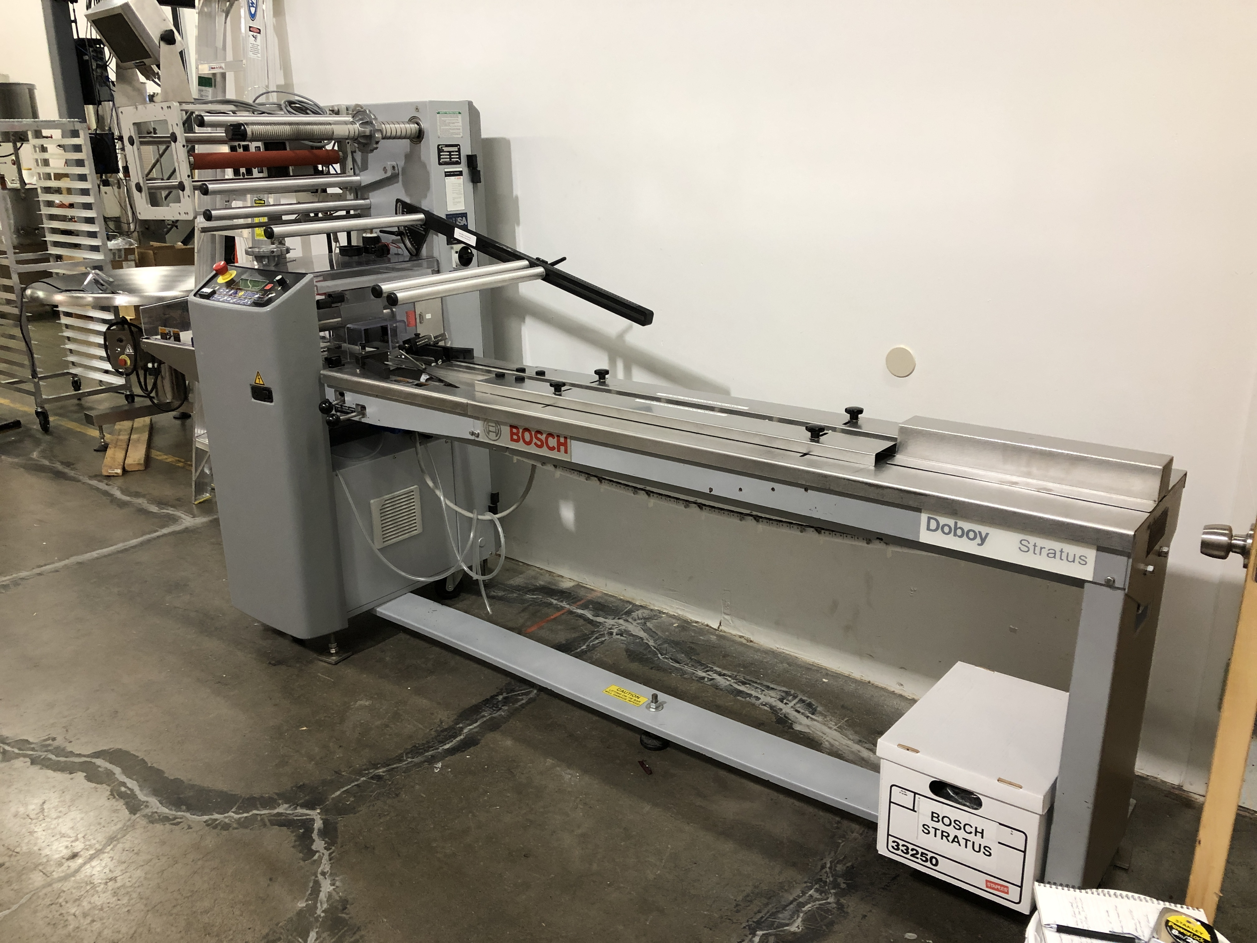 """Lot 33 - Doboy Stratus Horizontal Flow wrapper. 7"""" wide 1-up sealing jaw with extra knife blade, adjustable"""