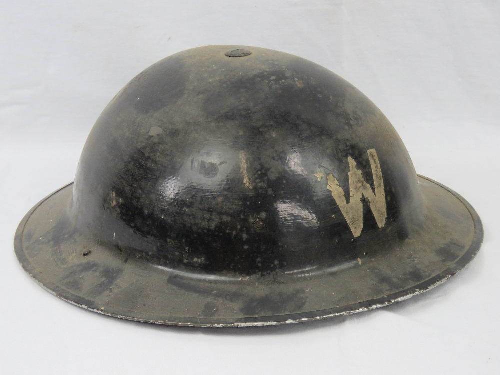 A WWII tin Wardens helmet having leather