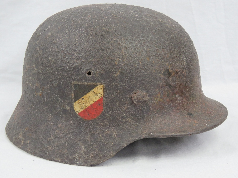 A WWII German Wehrmacht issue helmet in - Image 2 of 3
