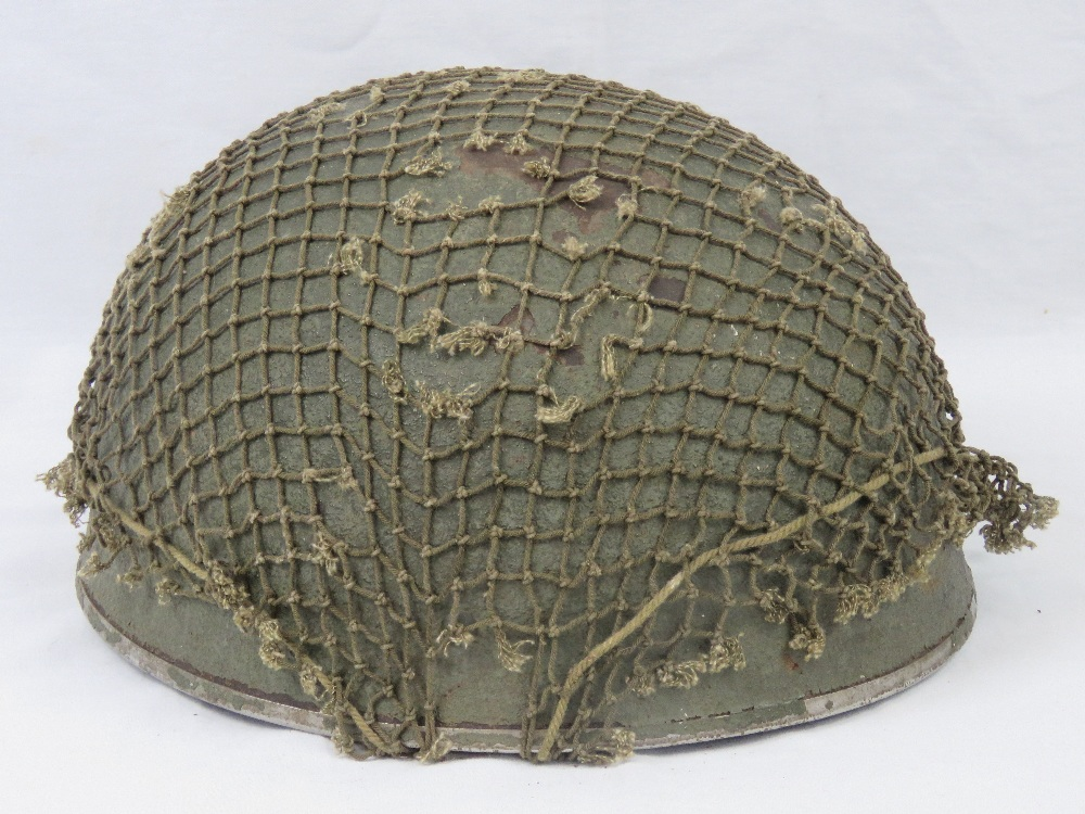 Lot 119 - A WWII British Paratroopers helmet with