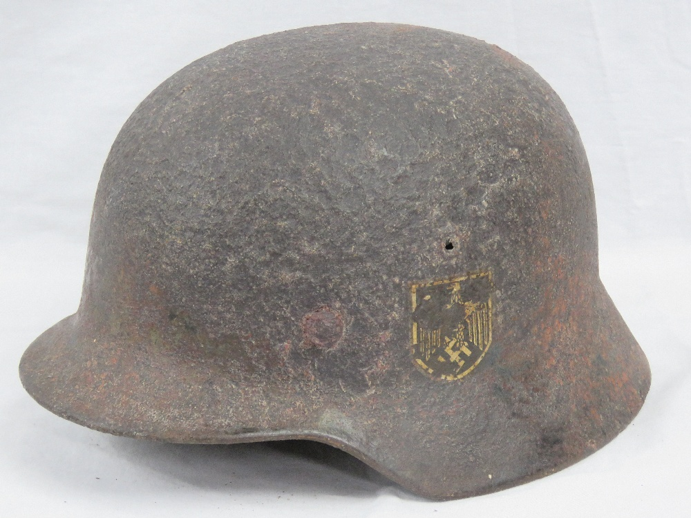 A WWII German Wehrmacht issue helmet in