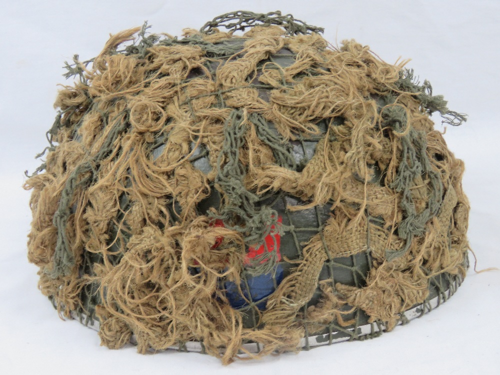A British Paratroopers helmet with scrim