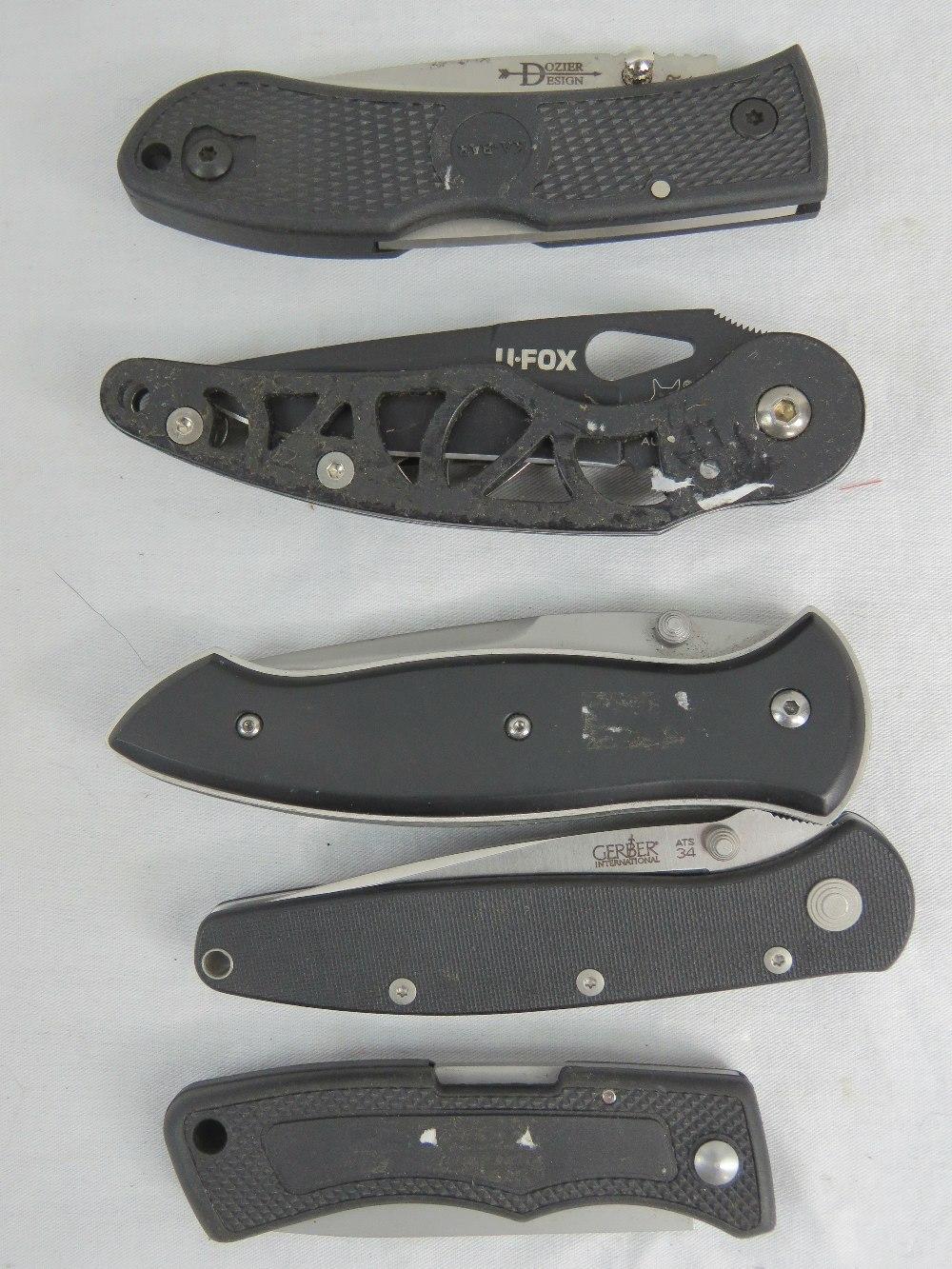 Lot 70 - Five lock knives including; Gerber, CRKT