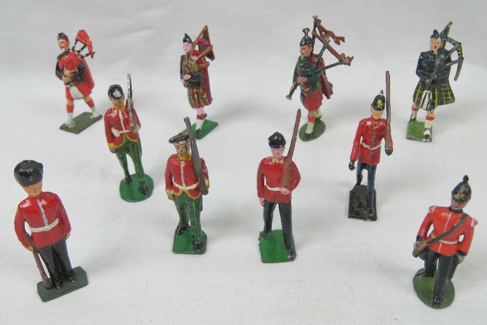 Four Britains toy soldiers Scottish regi