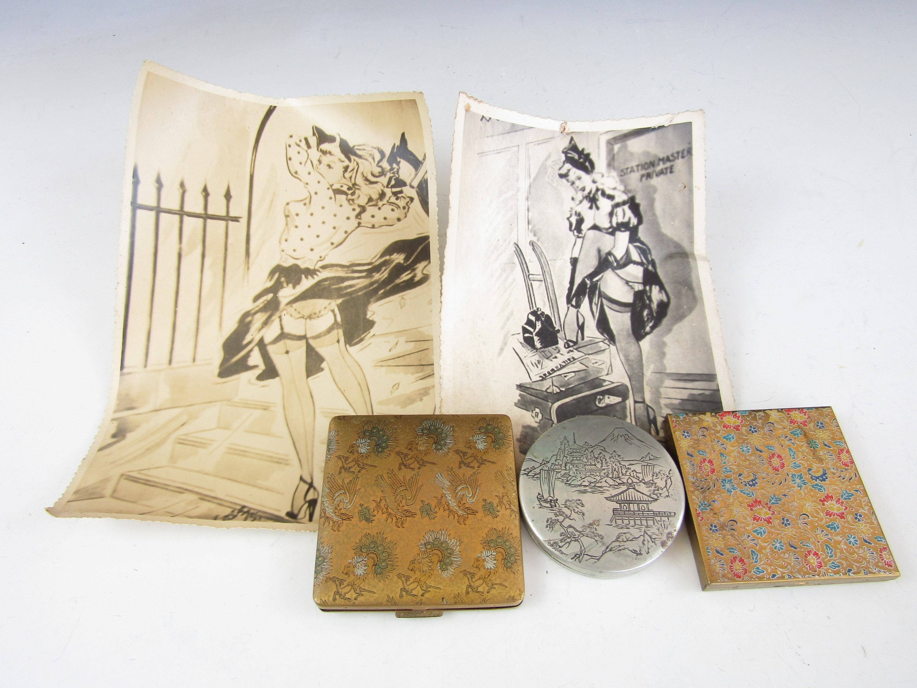 Lot 40 - A Vanity Fair compact together with one other, a Japanese pocket mirror and two 1940's cartoon