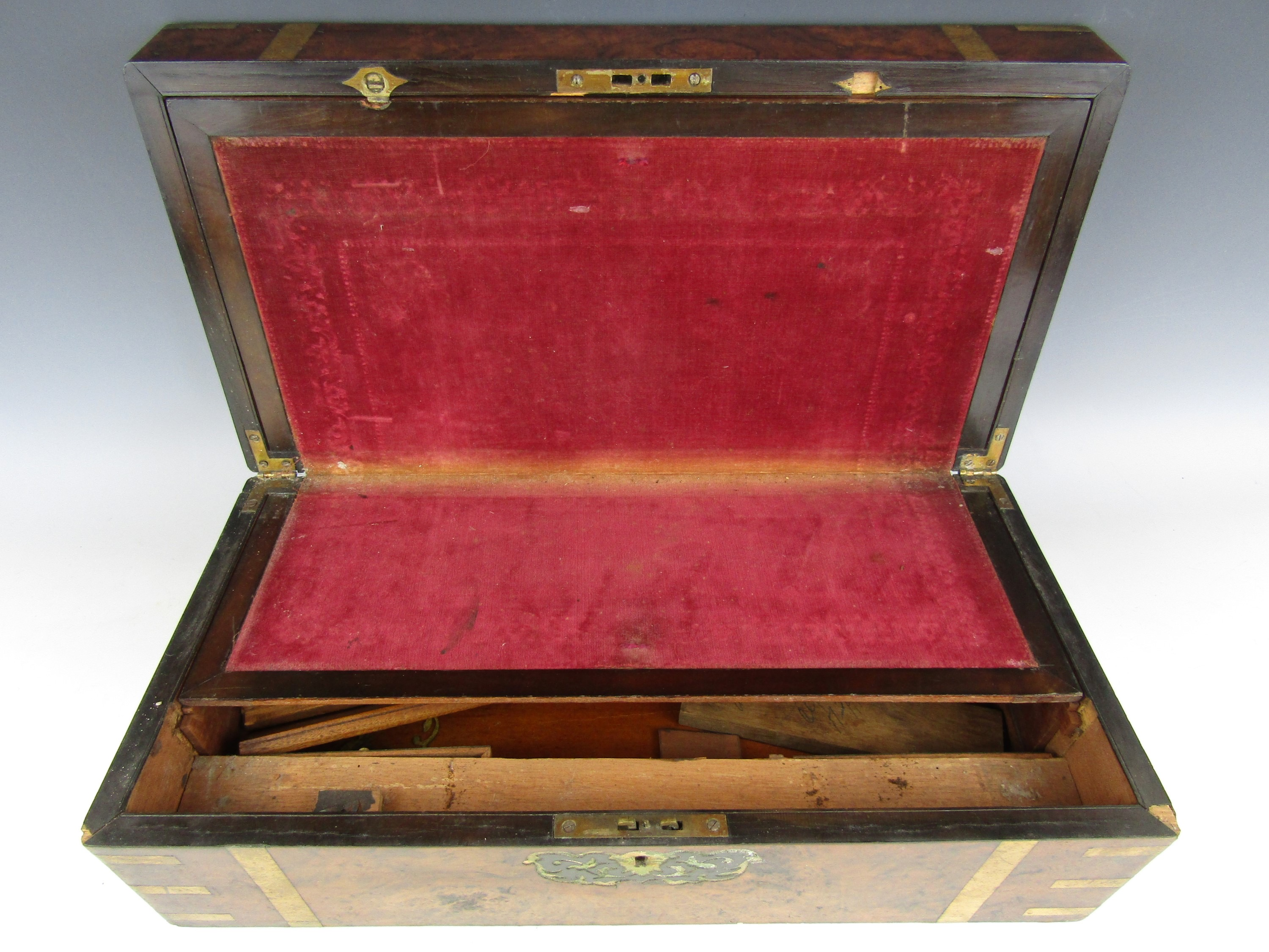 Lot 34 - A Victorian brass-inlaid burr walnut portable writing box